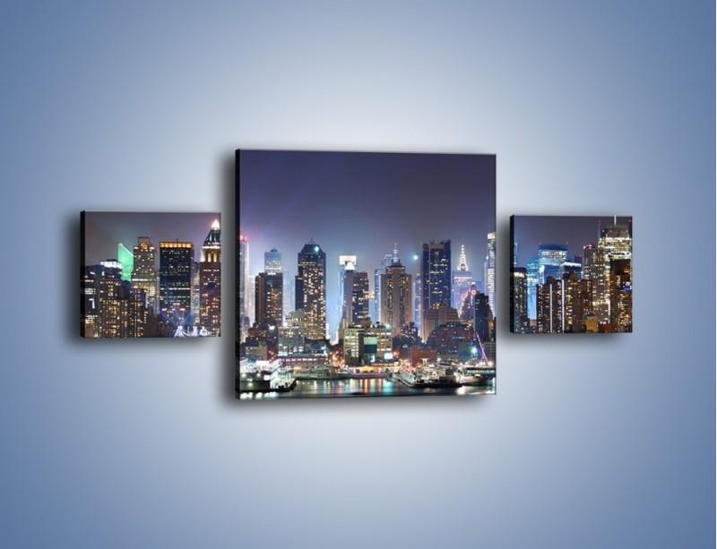 Obraz na płótnie – Oświetlone miasto nocą – trzyczęściowy AM034W4