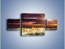 Obraz na płótnie – Błysk światła nad miastem wieczorową porą – trzyczęściowy AM063W4