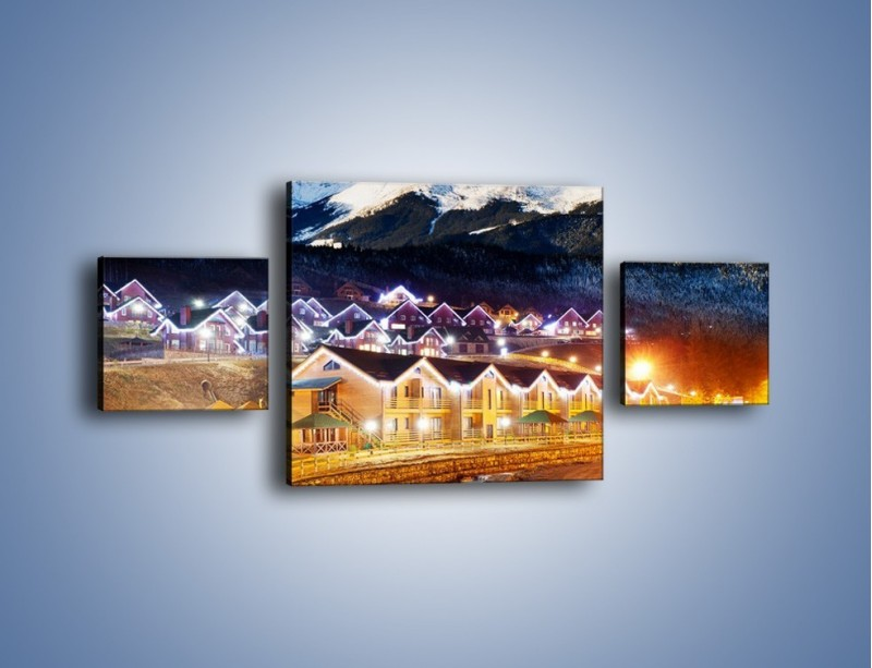 Obraz na płótnie – Oświetlone domki pod górami – trzyczęściowy AM070W4