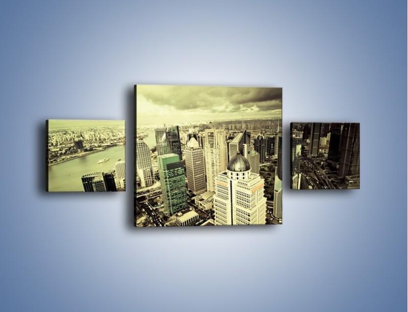Obraz na płótnie – Ciemne chmury nad miastem – trzyczęściowy AM130W4