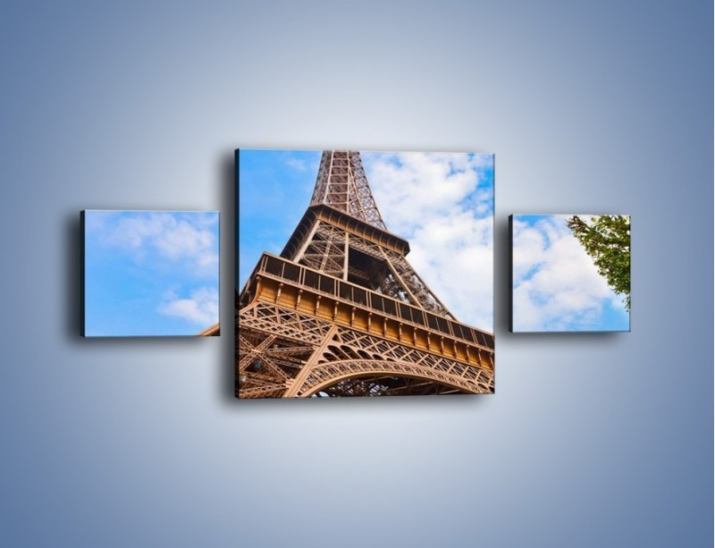 Obraz na płótnie – Wieża Eiffla pod chmurkami – trzyczęściowy AM173W4
