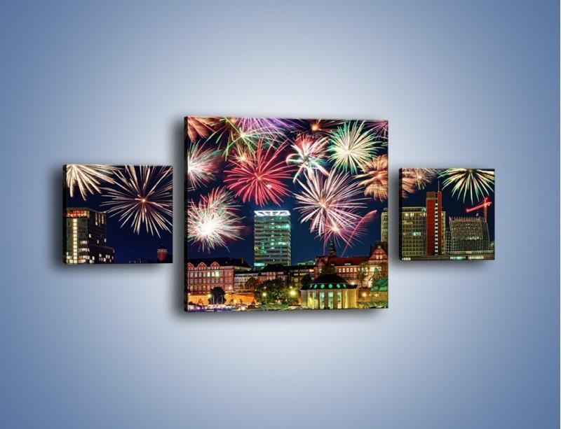 Obraz na płótnie – Noworoczne fajerwerki nad miastem – trzyczęściowy AM452W4