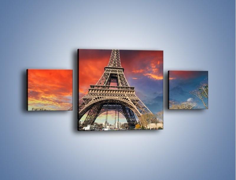 Obraz na płótnie – Wieża Eiffla pod niebiesko-czerwonym niebem – trzyczęściowy AM463W4