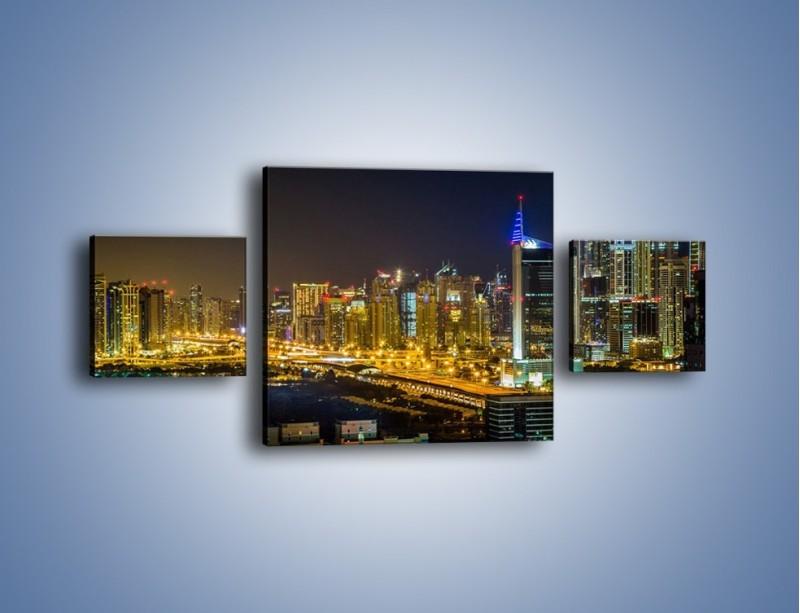 Obraz na płótnie – Oświetlony Dubaj nocą – trzyczęściowy AM506W4