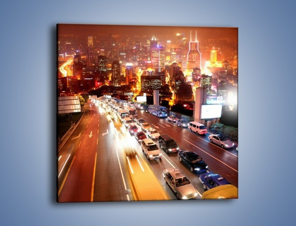 Obraz na płótnie – Wyjazd z zatłoczonego miasta – jednoczęściowy kwadratowy AM080