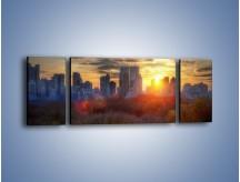 Obraz na płótnie – Wschód słońca nad miastem – trzyczęściowy AM318W5