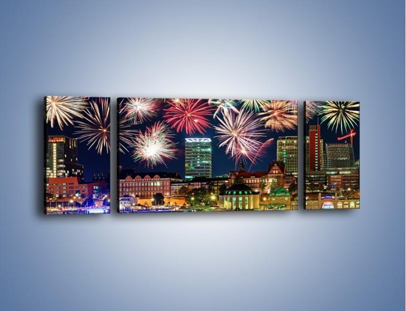 Obraz na płótnie – Noworoczne fajerwerki nad miastem – trzyczęściowy AM452W5