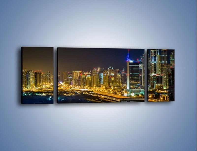 Obraz na płótnie – Oświetlony Dubaj nocą – trzyczęściowy AM506W5